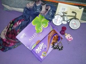 The gifts I got from friends on my pre-b'day party ^_^ - Chocolates, earrings, scarf, photo holder, lip balm, ear cap, and nail polish.
